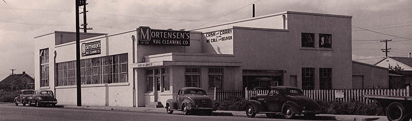 Mortensen and Son clean carpet business building black and white image